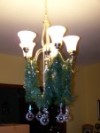 The greenery my son hung on our chandelier...along with the clear Christmas balls.