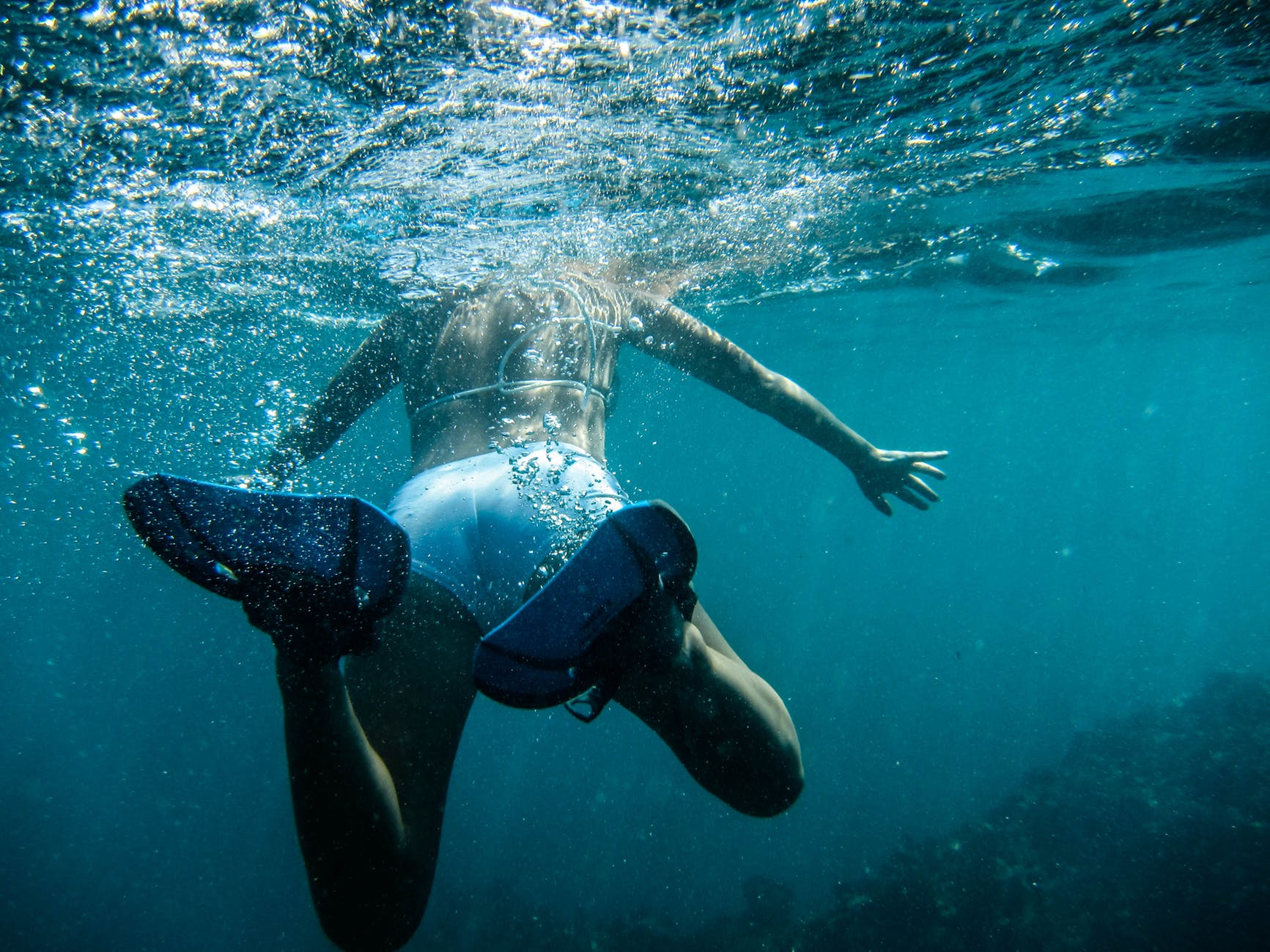 swimming underwater diving person
